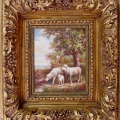 ornate soft gold frame on oil painting